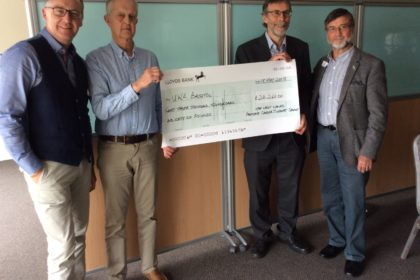 Ken presenting the group's £23,266 cheque to Professor Norman Ratcliffe with Chris Jones (L) and David Goddard (R).